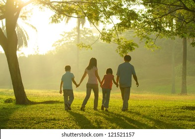 asian family silhouette during beautiful sunrise