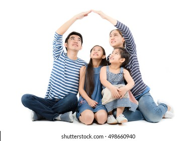 Asian family smiling and playing house by hands on isolated white background, Looking up