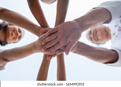 Asian family standing hands support together. Family generation join hands showing unity and teamwork.
