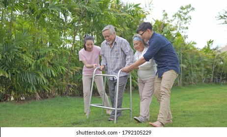 Asian family support senior farther use walker at home