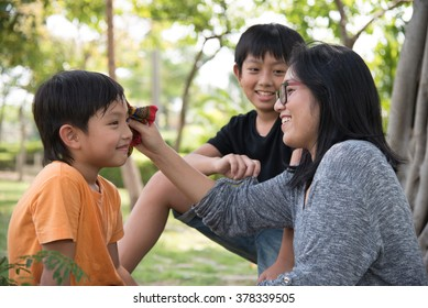 asian family take care happy sweat cute park mother son boy outdoor