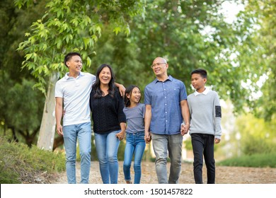 Asian family taking a walk outside and talking.