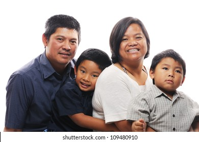 Asian family together looking happy