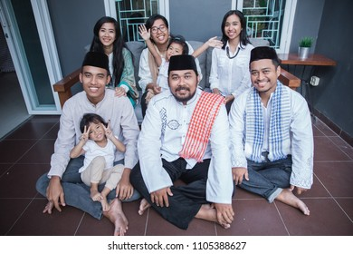 asian family together with muslim wear smiling to camera