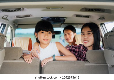 Asian family travel in car .Happy family sitting in car smiling.Car insurance concept