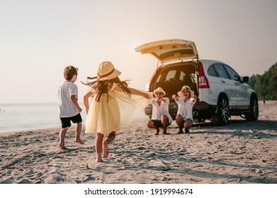 Asian family vacation holiday, Happy family running on the beach in the sunset.Children are running to their parents behind cars.Holiday and travel family concept, Summer vacations.
