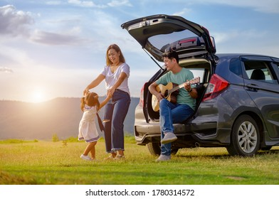 Asian family.happy little girl with family sitting in the car.Car insurance concept