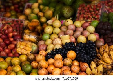 Asian farm market, fresh colorful ripe fruit and vegetables  Different fresh farm fruit and vegetables. Autumn harvest and healthy organic food concept.