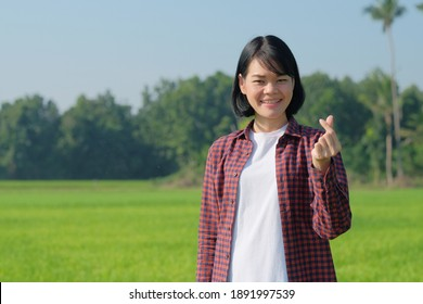 Asian farmer woman pose hand holding things with smile face