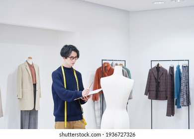 Asian fashion designer working at the office