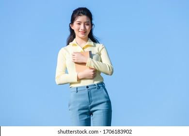 Asian fashion girl in blue sky