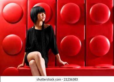Asian fashion model on red background