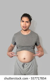 asian fat man looking you because  he's belly