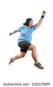 Asian fat man running isolated over white background. Fat man diet concept