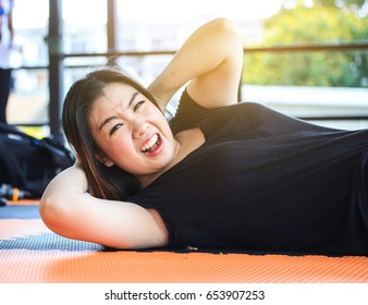 asian fat woman take  six pack course in gym