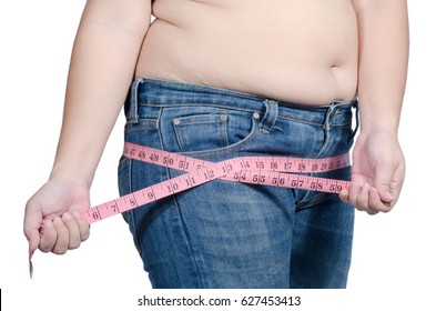 asian fat women has overweight. she measuring hips girth with measure tape. isolated on white background. she wants lose weight. concept of surgery and subcutaneous fat breakdown.