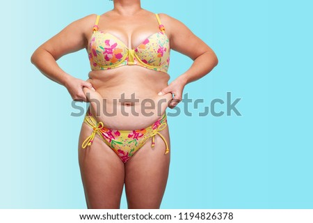 dc5deb386eeb9 asian fat women has overweight. sagging skin. she used hands squeezing excess  fat of