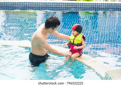 Asian father and adorable little daughter are playing together with fully  happiness moment, concept of activity for warm family lifestyle.