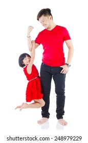 Asian father lifting up his cute daughter. Fathers day concept.