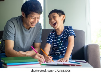 Asian father and son enjoy painting at home. Family activities and study at home concept
