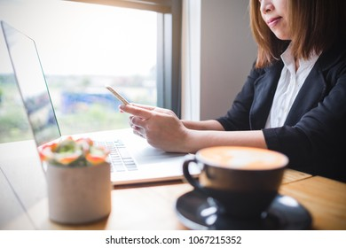 Asian female accountant or banker economy concept.View business education in the mobile market.