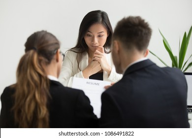 Asian female applicant feeling nervous stressed at job interview concept, serious millennial chinese candidate in panic afraid of rejection, failed performance or bad first impression talking to hr