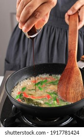 Asian Female Chef Hand Add Sweet Soy Sauce to the Pan, Cooking Process Making Delicious Food