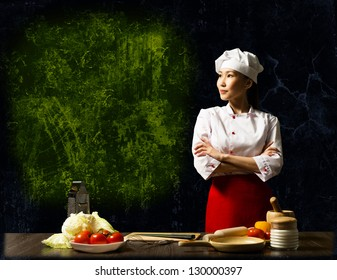 Asian female chef looking at the empty space for text