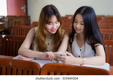 Asian female college students to study in classroom