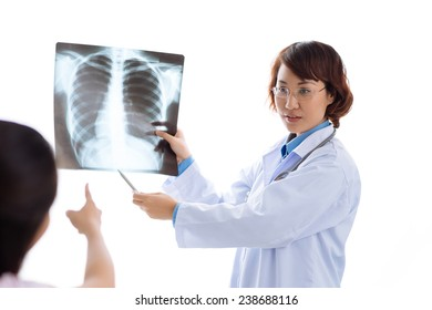 Asian female doctor explaining x-ray results to the patient