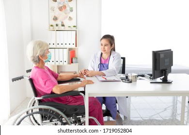 asian female doctor holding hand of old patient in mental health clinic, patient have a problem health in hospital, hand in hand, elderly healthcare promotion