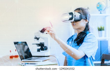 Asian female doctor wearing virtual reality glasses (VR box) testing result with simulator Mixed media futuristic medical interface, Future Innovative technology science medicine Medical concept