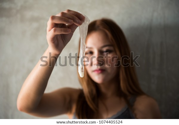 Asian Female Hand Holding Used Condom Stock Photo Edit -6534