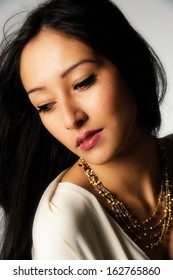 Asian female model with golden necklace