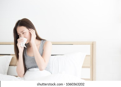 asian female patient stay on white bed, influenza virus, she cough and sneeze , headache