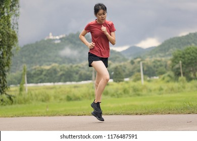 Asian female Runner Running and workout at countryside