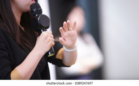 Asian female speaker in presentation