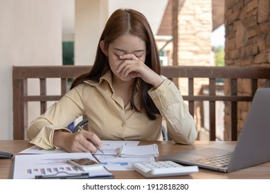 Asian female staffers are disappointed by the mistakes made, Despair or disappointment, Disappointed, very sad, and frustrated, feeling hopeless at work, Failure of life concept.