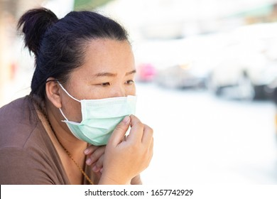 Asian female tourist with hygienic mask to protect PM 2.5 dust and coronavirus or covid-19 virus - Shutterstock ID 1657742929