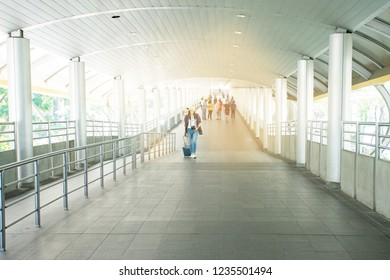 Asian female travel look for room for rent walk on skywalk in Bangkok city, Thailand. Woman are have plan travel in weekend. Travel and people concept