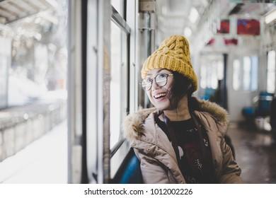 Asian female traveler in train