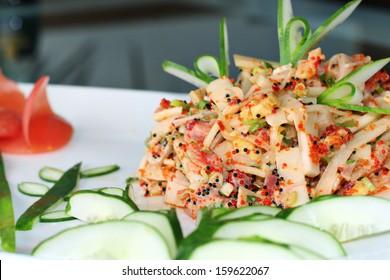 Asian fish salad cucumber butterfly garnish