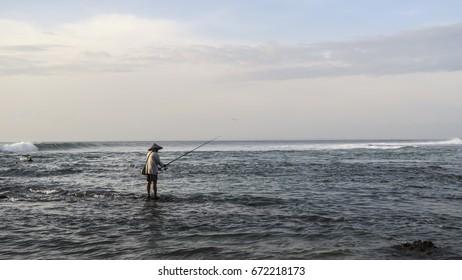 Asian fisherman in the beach