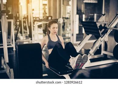 Asian fit woman doing situp or crunches in gym,Female exercise muscular her stomach