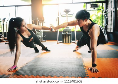 Asian fitness couple in sports dress doing fitness exercise at gym,healthy sports lifestyle,relax concept.