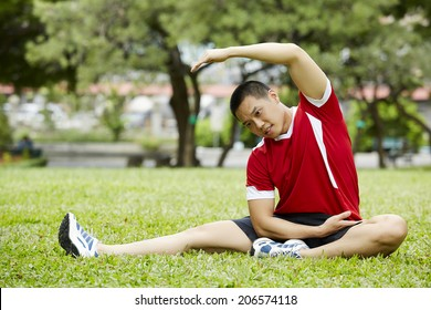 Asian fitness man stretching at the park - fitness concepts sports exercises.