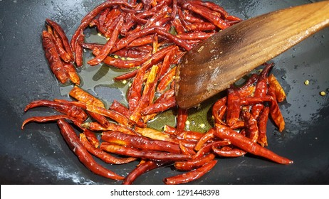 asian flavoring fried red chilli, spicy ingredients in the pan. top view
