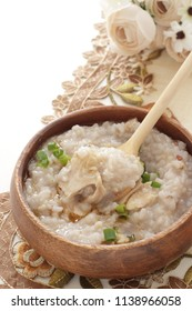 Asian food, 16 grains congee and chicken with sesame oil