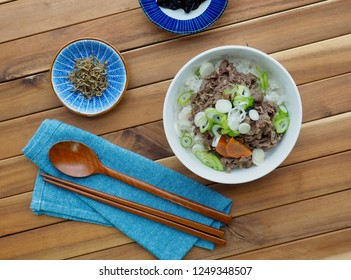 Asian food Bulgogi with Rice, A bowl of rice topped with bulgogi