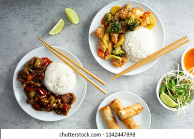 Asian food concept with sweet and sour chicken, tangerine beef and egg rolls